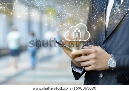 Business man works in a public network with protected information. Foto stock ©