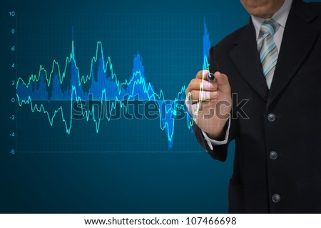 Business Man write graph