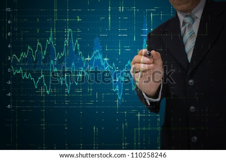 Business Man write graph on transparent digital screen