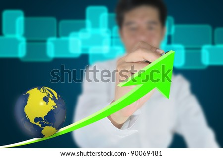 Business man write growth graph with earth globe