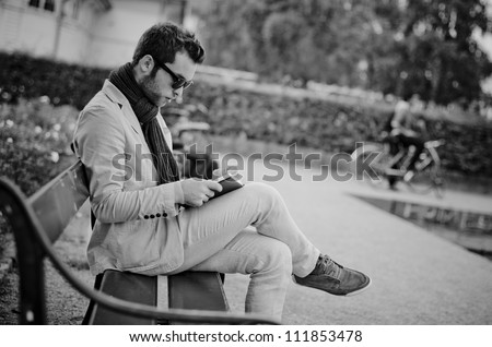 Business man write his tasks in a notebook, black and white photography
