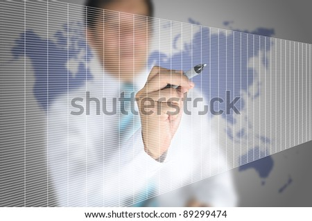 Business man write on touch screen display