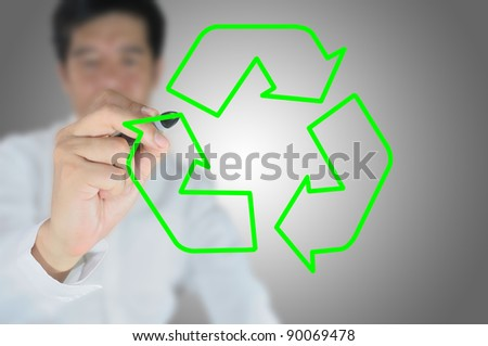 business man write recycle sign
