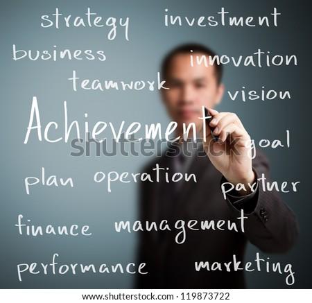 business man writing achievement concept