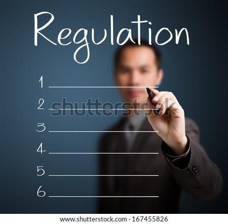 business man writing blank regulation list