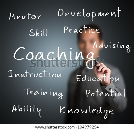 business man writing coaching concept