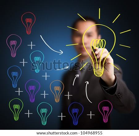 business man writing concept of  combining of many different small idea is one big great idea