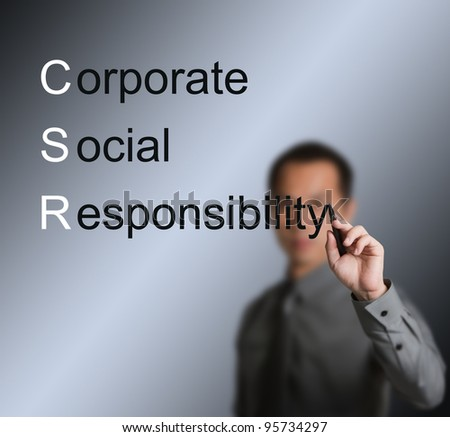 business man writing CSR concept ( corporate social responsibility ) on white board