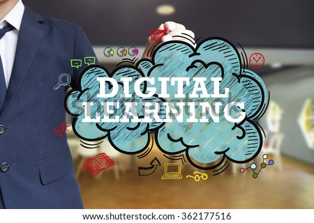 business man writing DIGITAL LEARNING  over the cloud with office background , business concept , business idea