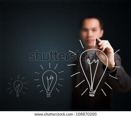 business man writing growth light bulb - development symbol of think, idea, innovation, solution, creative, vision, smart