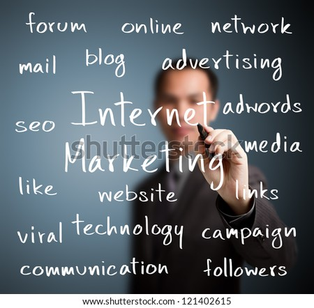business man writing internet marketing concept