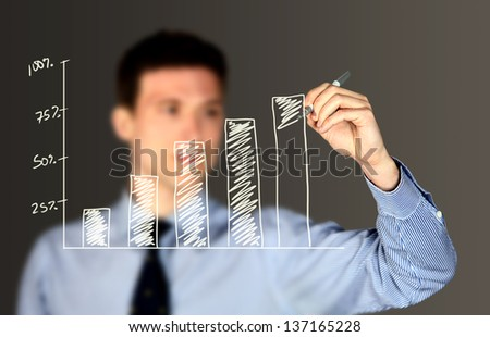 Business man writing on a board