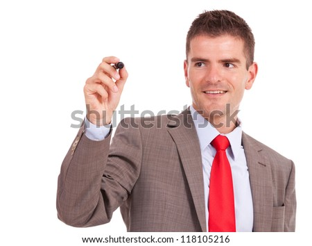 Business man writing on imaginary screen with marker isolated on white background