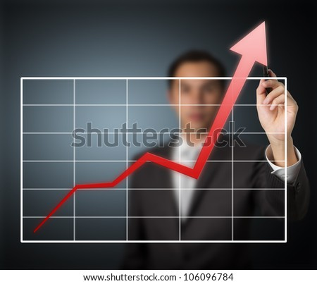 business man writing over achievement graph