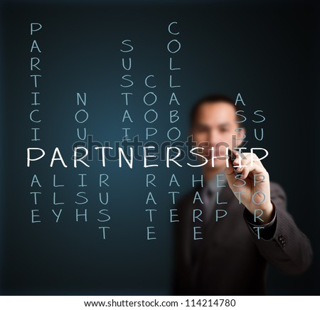 business man writing partnership concept by crossword of relate word such as ally, sustain, help, support, assist, share, etc. - stock photo
