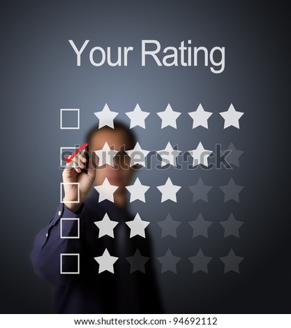 business man writing red mark on four star choice on rating survey form