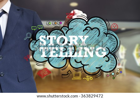 business man writing STORY TELLING over the cloud with office background , business concept , business idea