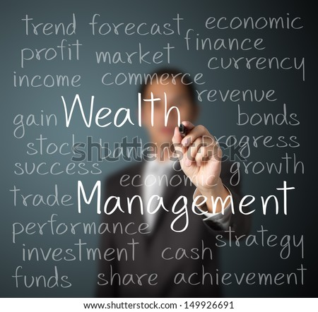 business man writing wealth management concept