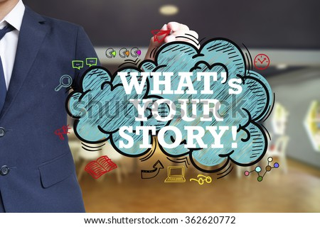 business man writing WHAT'S YOUR STORY over the cloud with office background , business concept , business idea