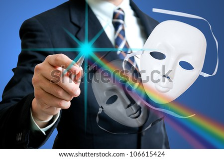 Business man your pen for creative the dramatic human face in the world business. White and back mask for show case concept ,good and bad businessman.