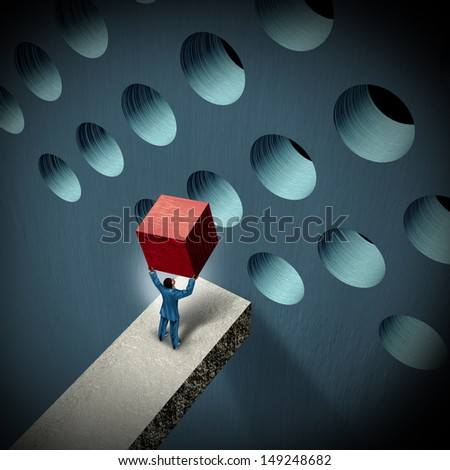 Business management challenges concept as a businessman holding a cube trying to make it fit in a round hole as a symbol of overcoming obstacles and adversity through strategy and strong leadership. Stock photo ©