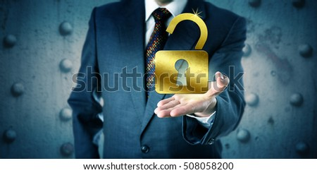 Business manager is offering a golden open padlock in the palm of his outstretched left hand. Business concept for access, security, secrecy, accessibility, protection, privacy, success, and wealth. #508058200