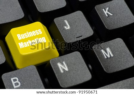 business marketing words on yellow and black keyboard button
