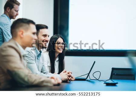 Business meeting and presentation  in modern conference room for colleagues