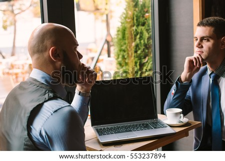 Business meeting at the cafe