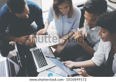 Business meeting concept.Coworkers team working new startup project at office.Analyze business documents, laptop on table.Blurred background.Horizontal.