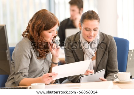 Business meeting - group of people in office sitting at computer desk