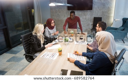 Business meeting in a modern office, multiracional colleagues collaborating together.  #689582764