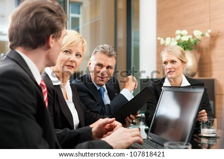 Business - meeting in an office, the businesspeople are discussing a project - stock photo