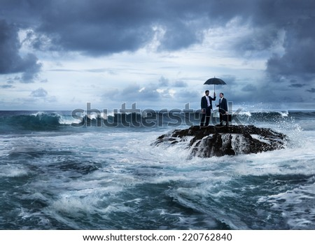 Business meeting in stormy ocean