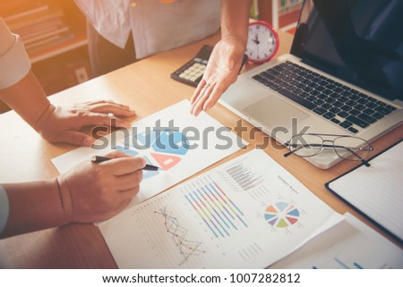 Business meeting, man's hands pointing on charts. Reflection light and flare. Concept image of data gathering and statistical working. #1007282812