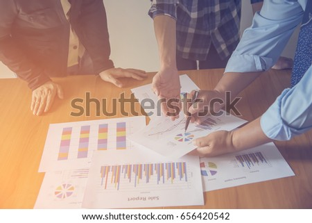 Business meeting, man's hands pointing on charts. Reflection light and flare. Concept image of data gathering and statistical working. #656420542