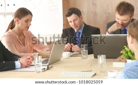 Business meeting -  manager discussing work with his colleagues #1018025059