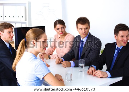 Business meeting - manager discussing work with his colleagues #446610373