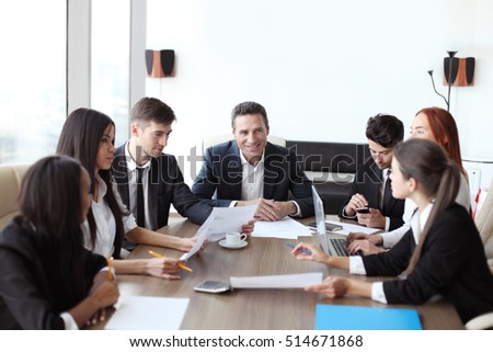 Business meeting of diverse people around the table