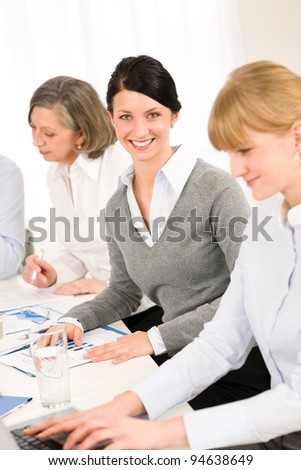 Business meeting teamwork in the office young woman smiling - stock photo