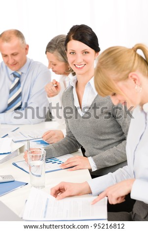Business meeting teamwork in the office young woman smiling