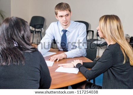 Business meeting - Young man presenting his ideas to colleagues