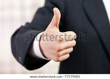 Business men hand gesturing thumb up success sign