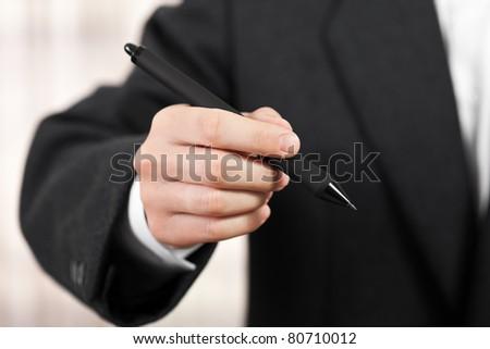Business men hand hold paper writing ballpoint pen - stock photo