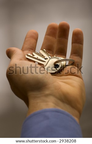 business men hand holding keys close up