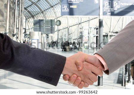 business men handshake at office building