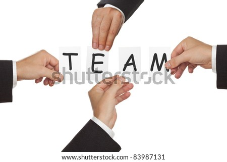 Business men's hand holding cards forming the word Team