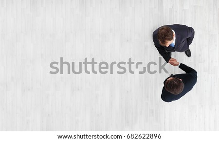 Business men shaking hands, finishing up a meeting, top view with copy space #682622896