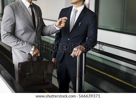 Business Men Travel Luggage Escalator Talk #566639371
