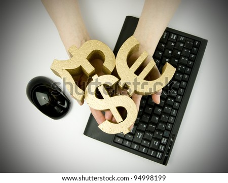 business money / finance, woman holding gold money symbols with keyboard and mouse
